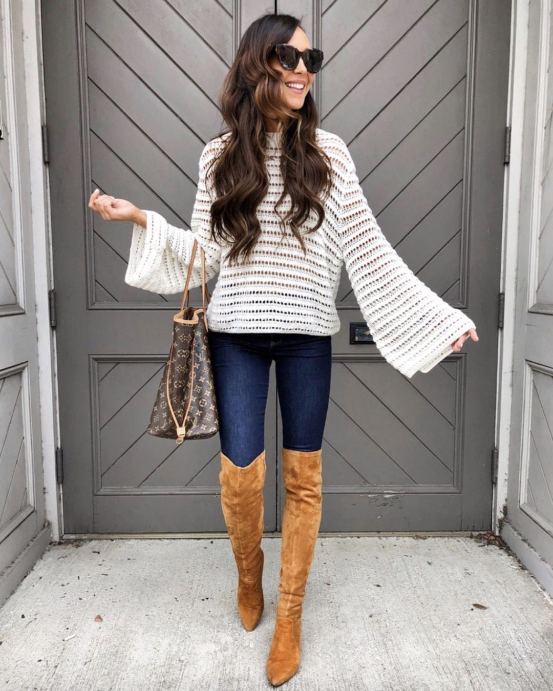Tan over the knee boots outfits with jeans, white sweater and Louis Vuitton Neverfull
