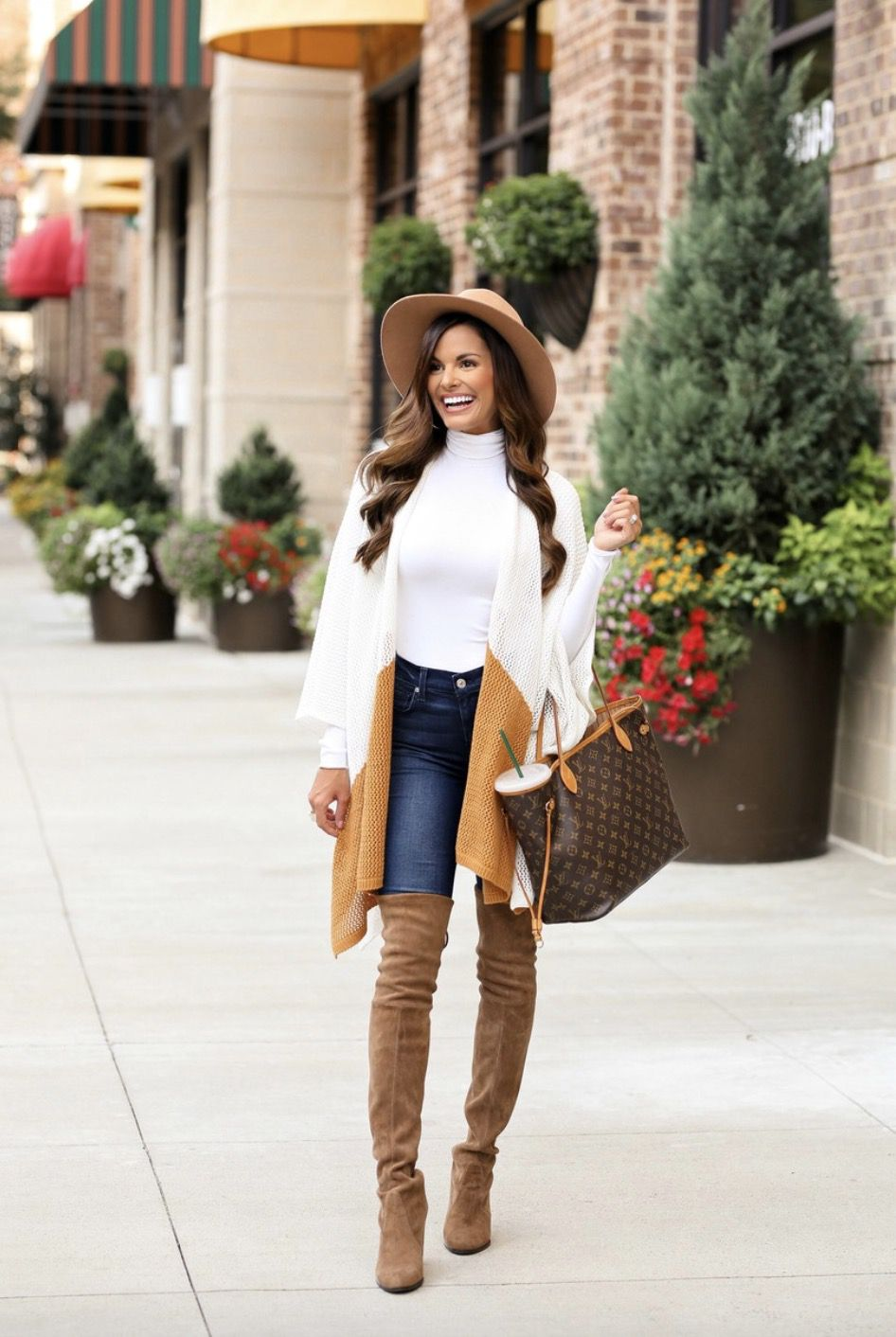 Tan over the knee boots outfits with jeans and Louis Vuitton Neverfull