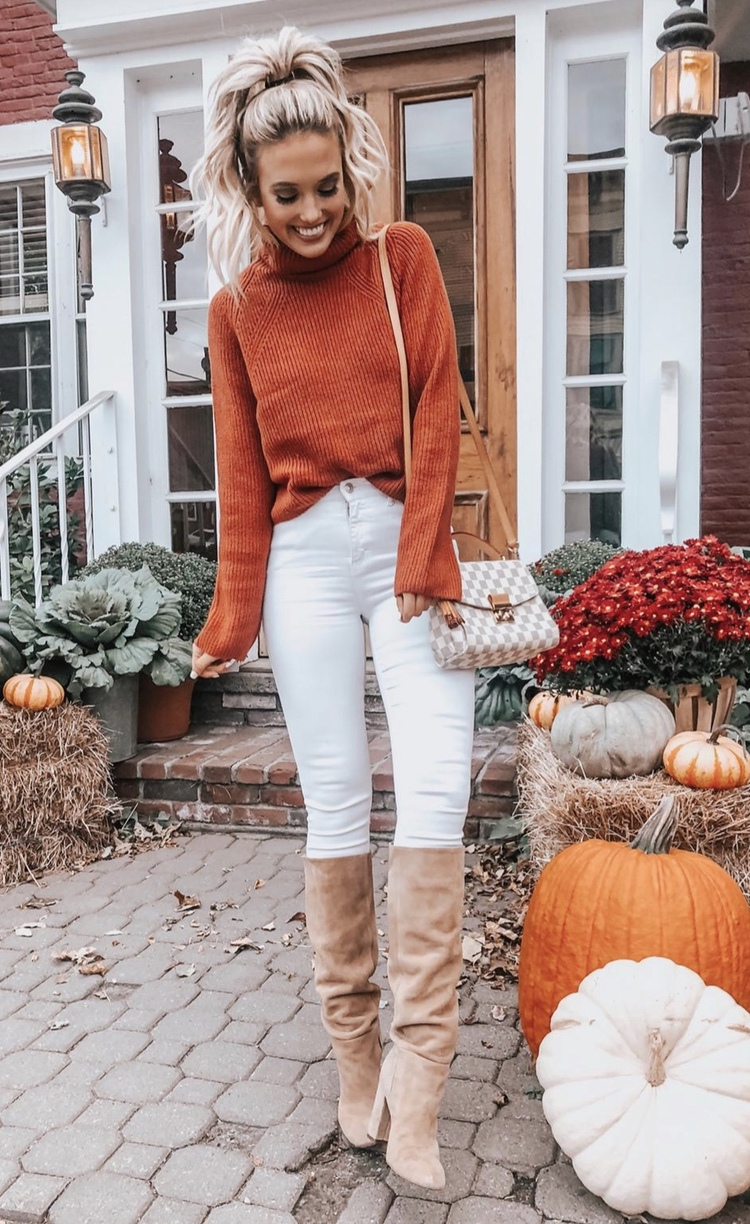 21+ Winter Outfits To Copy ASAP: Colorful orange sweater with white jeans. These casual winter outfits will keep you warm when other cold weather outfits may fail you. Check out these over the knee boot outfit looks, sweater outfits and other winter fashion outfits from the biggest fashion bloggers to get inspired now! Image ©ChampagneAndChanel #winterfashion #winteroutfits #casualwinteroutfits #sweaters