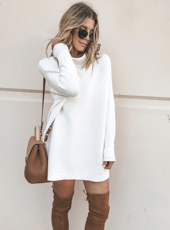 17 Trendy winter street style outfits and outfit ideas to step up your game this fall and winter: White sweater dress with OTK boots. These winter street style looks are perfect to cosy up with in any urban city. Click over to the article and get inspired by more casual winter fashion looks! Image © CellaJaneBlog. #winterfashion #winteroutfits #streetstyle #sweaterdress #overthekneeboots