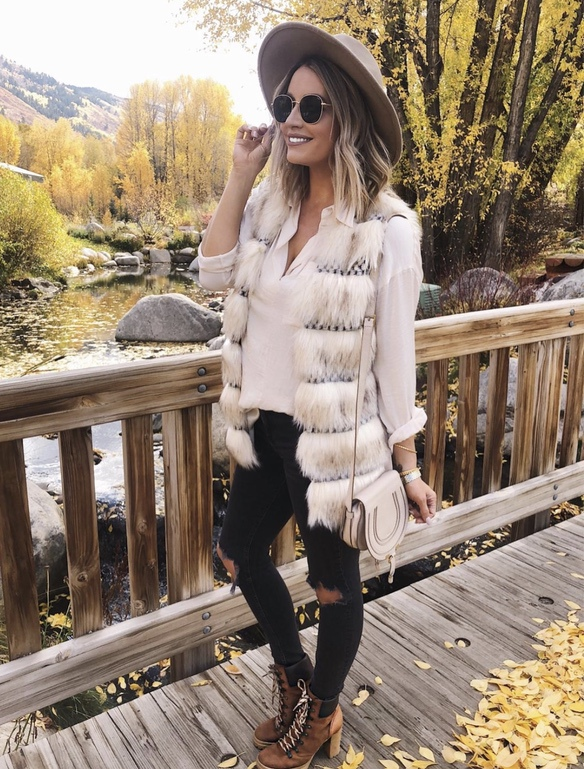 21+ Winter Outfits To Copy ASAP: Faux Fur Vest. These casual winter outfits will keep you warm when other cold weather outfits may fail you. Check out these over the knee boot outfit looks, sweater outfits and other winter fashion outfits from the biggest fashion bloggers to get inspired now! Image ©SarahKnuth #winterfashion #winteroutfits #casualwinteroutfits #fauxfur