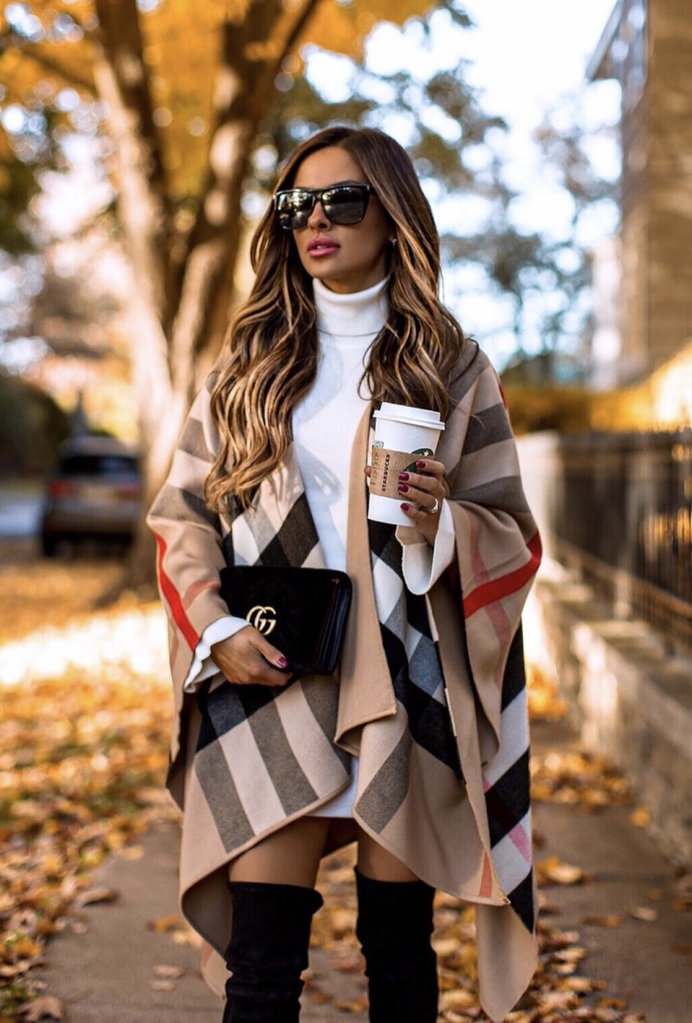 Chic winter outfits: Burberry scarf outfit / Burberry poncho with white sweater dress, black over the knee boots and Gucci bag worn by Mia Mia Mine
