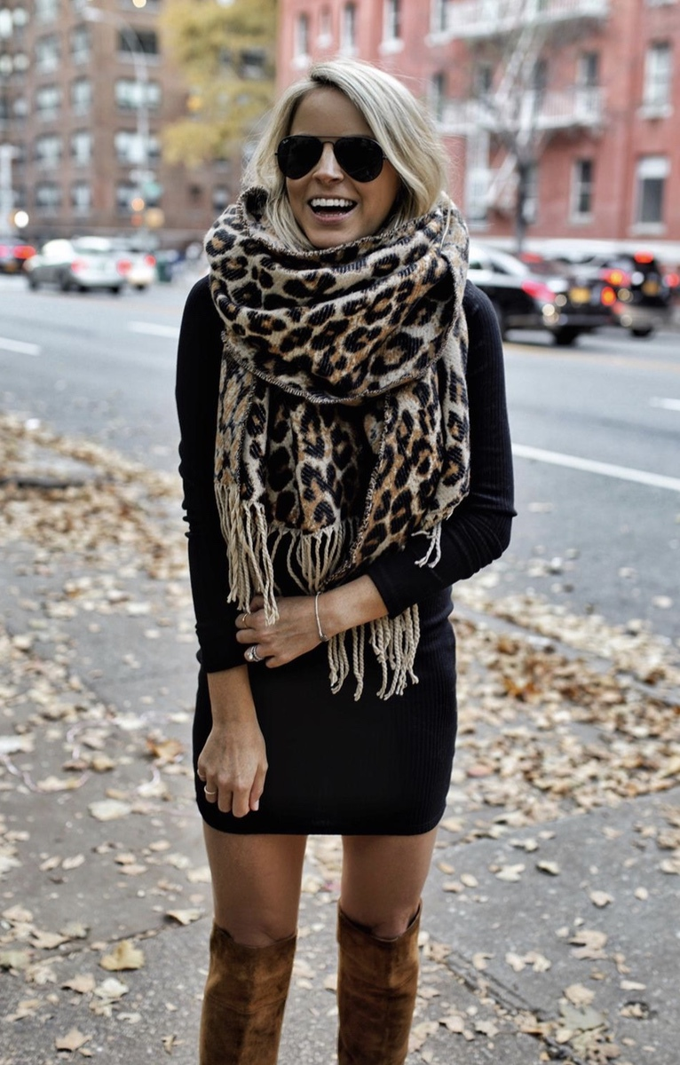Casual fall outfits with leopard print scarf, black sweater dress and tan over the knee boots and Ray Ban aviator sunglasses worn by StyledSnapshots.