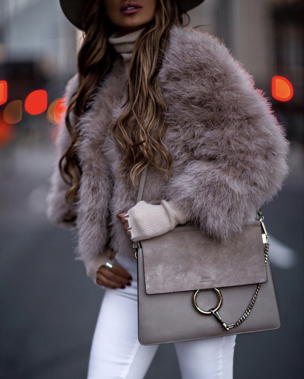 Chic winter outfits with pink faux fur coat, Chloe Faye bag and white jeans worn by MiaMiaMine
