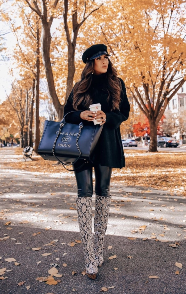 Cute winter outfits with snake print boots, black sweater dress and baker boy hat worn by Emily Ann Gemma
