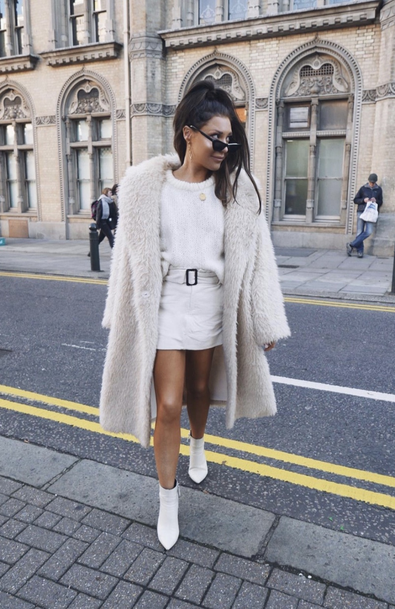 Chic and casual winter outfits with white teddy coat and white boots worn by Lorna Luxe