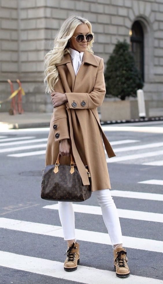 Chic casual outfits worn by Macy Stucke in a camel coat and white jeans