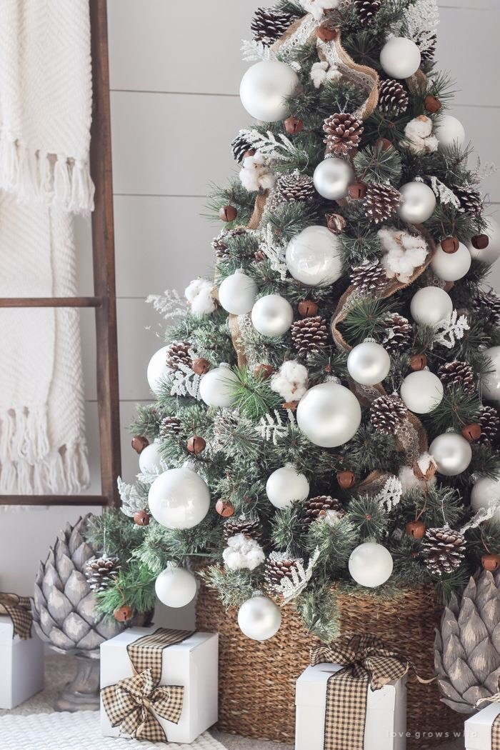 Rustic Christmas tree with pinecones and white decorations