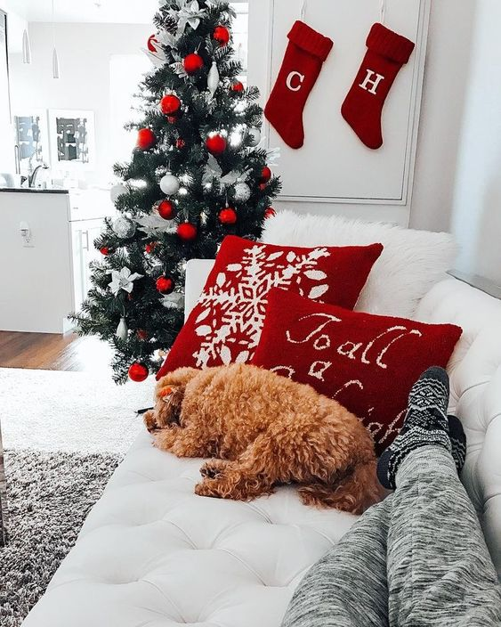 Christmas wallpaper aesthetic with dog, Christmas stockings and white and red decorated Christmas tree
