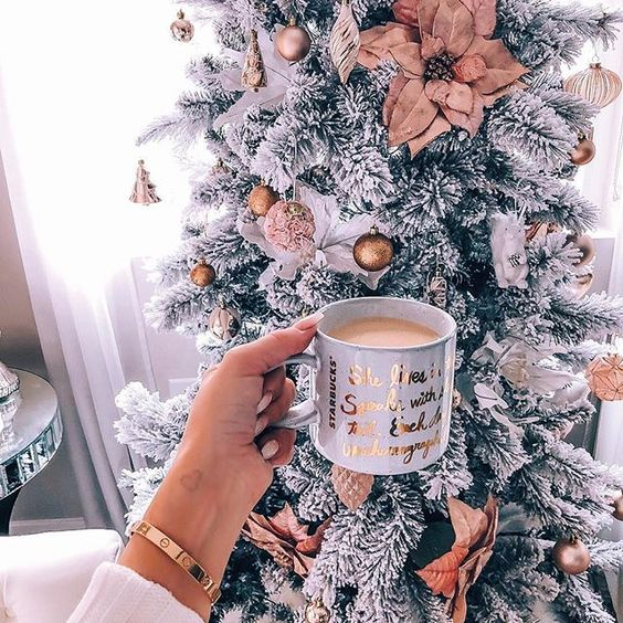 Christmas wallpaper aesthetic with decorated white Christmas tree and coffee