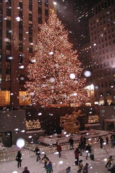 Christmas wallpaper aesthetic with Rockefeller Christmas tree in New York City with snow