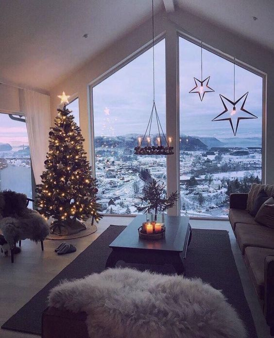 Aesthetic Christmas wallpapers iPhone with decorated Christmas tree, penthouse view and snow