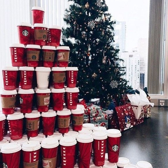 Christmas wallpaper aesthetic with red Starbucks cups and green Christmas tree