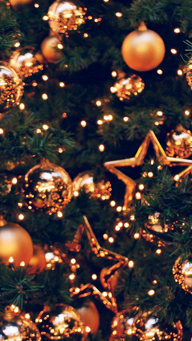 Christmas wallpaper aesthetic with gold baubles and decorated Christmas tree