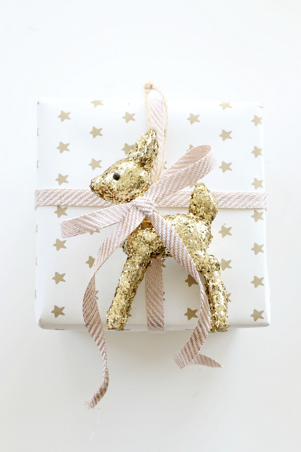Elegant White, Pink & Gold Gift Wrapping With Gold Reindeer Toy