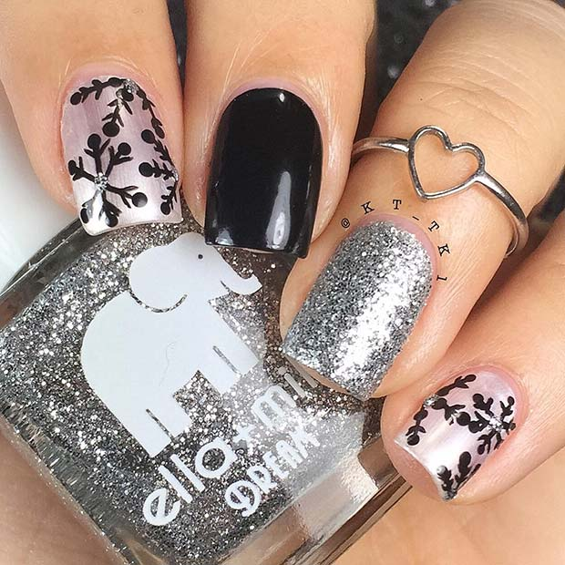 Silver glitter, black and pink Christmas nails with snowflakes