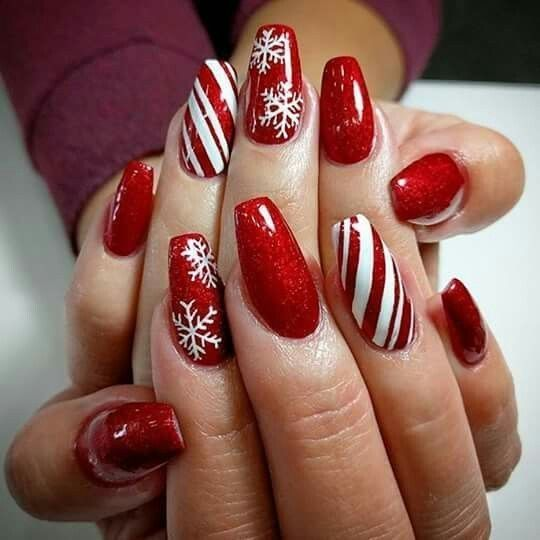 Cute red Christmas nails with snowflakes and candy cane stripes