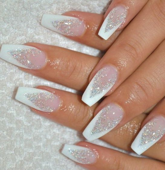Cute white Christmas nails with glitter and acrylic coffin shape
