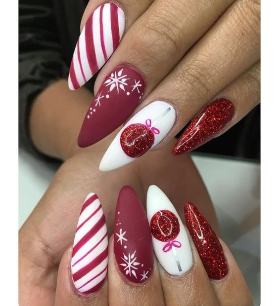 Red and white Christmas nails with snowflakes, baubles and candy cane stripes - almond acrylic nails