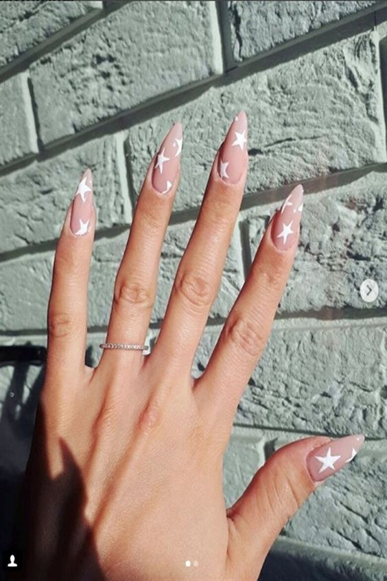 Cute nude nails with stars and almond acrylic nails