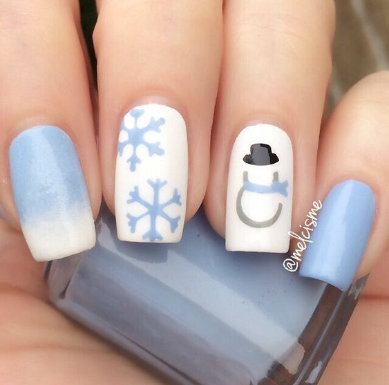 Blue and white Christmas nails with snowflakes and snoowman nail art