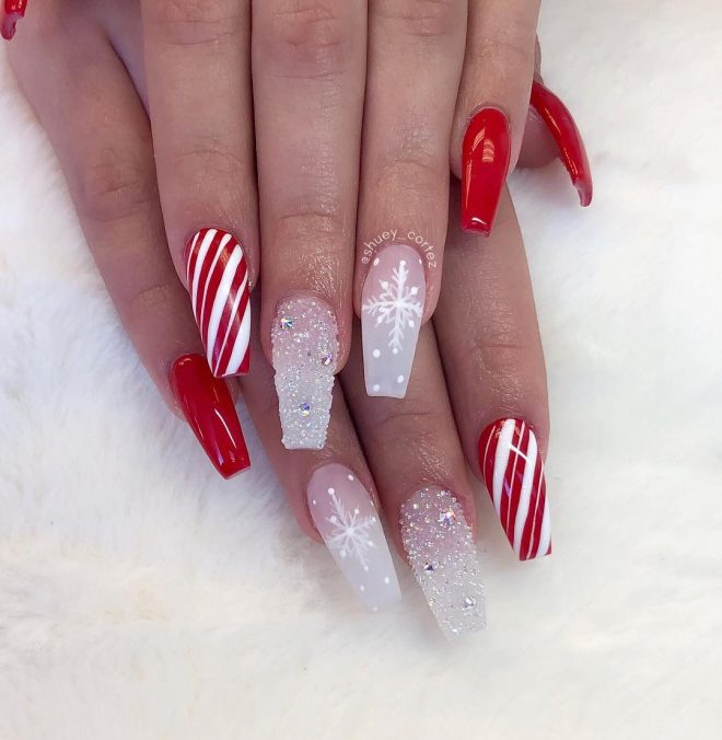 Red and white holiday nails with snowflakes and candy cane stripes - acrylic coffin nails