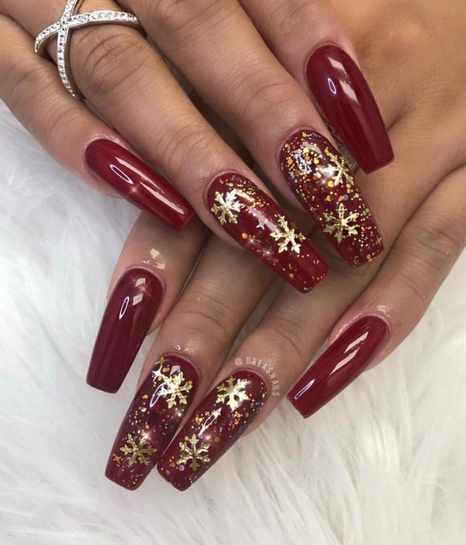 Gold and red holiday nails with snowflakes