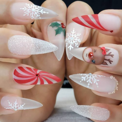 White Christmas nail art - snowflake nails, Rudolf nails and transparent nails on acrylic nails with almond shape
