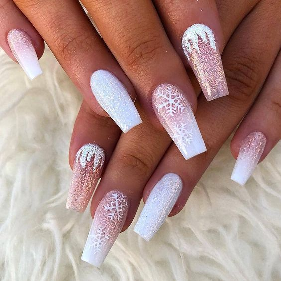 Pink and white Christmas nails with snowflakes and sparkling glitter