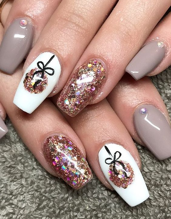 Sparkling gray and pink holiday nails with glitter and baubles