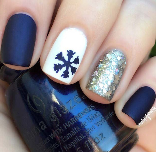 Matte blue and white Christmas nails with snowflakes and glitter