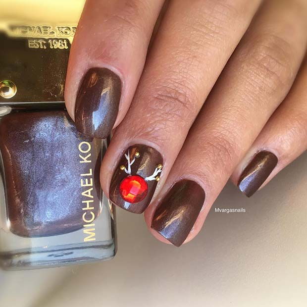 Cute brown Rudolph nails on short nails