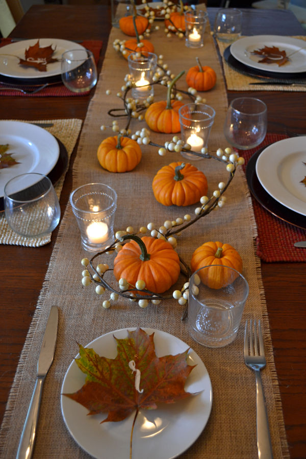 DIY rustic Thanksgiving table settings with pumpkins, candles and lights