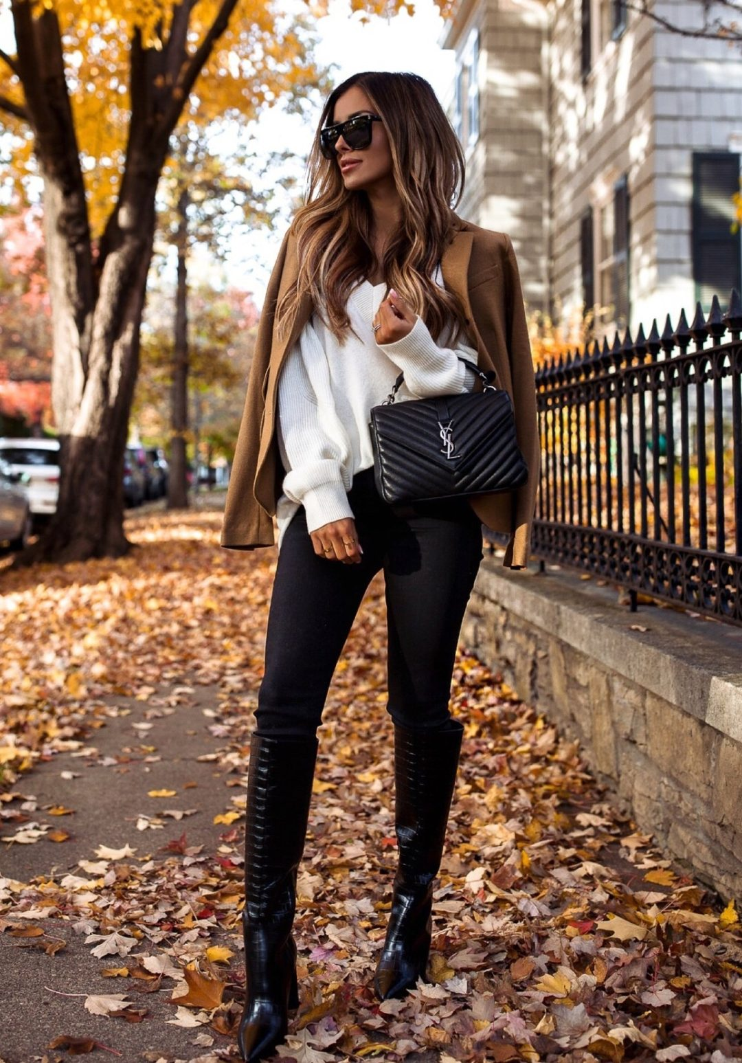Chic black leggings outfit idea with YSL bag