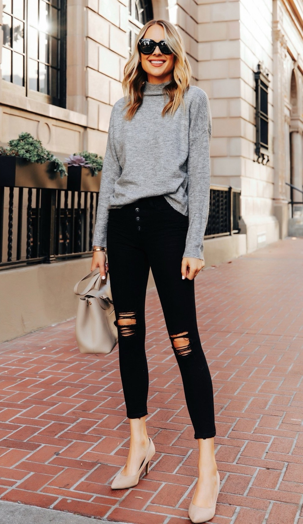 Black ripped jeans outfit with grey sweater