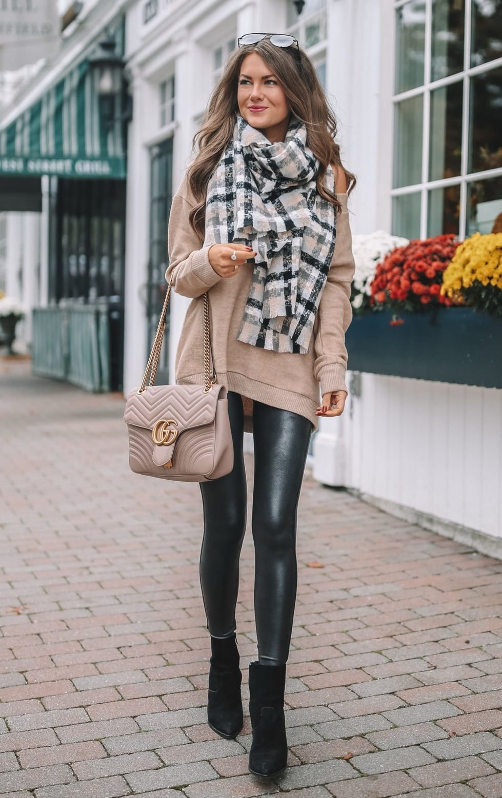 Cute black leggings outfit idea with plaid scarf, beige sweater and Gucci bag