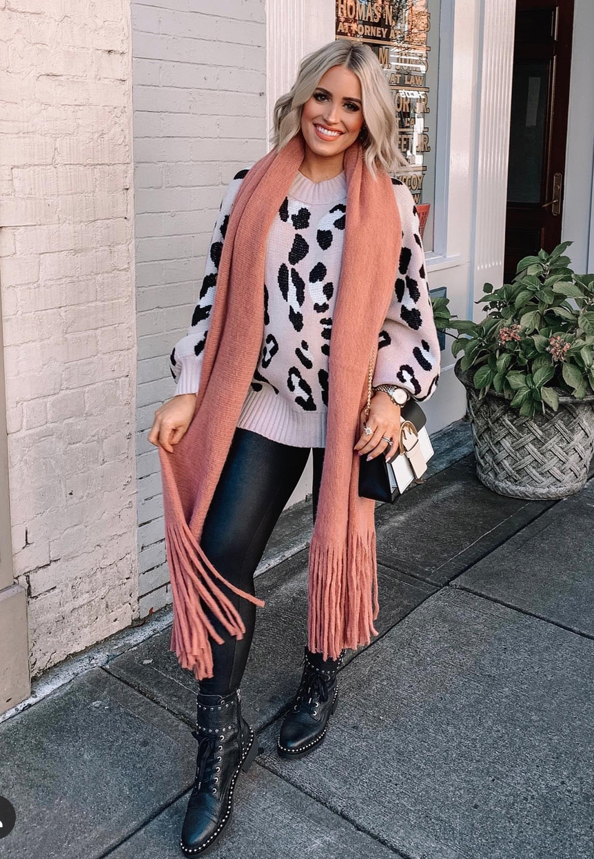 Pink animal print sweater outfit with black leggings and scarf