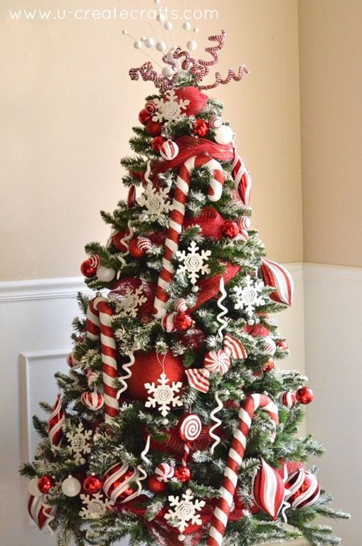 Red and white Christmas tree with candy canes and decorations