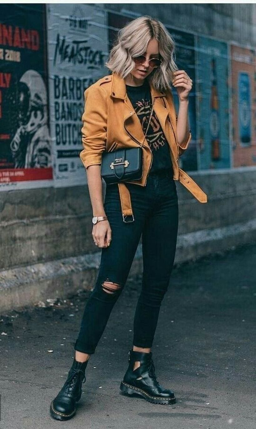 Black jeans outfits with mustard leather jacket and doc martens