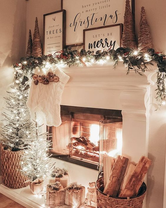 Rustic Christmas decor with white fireplace and Christmas stockings