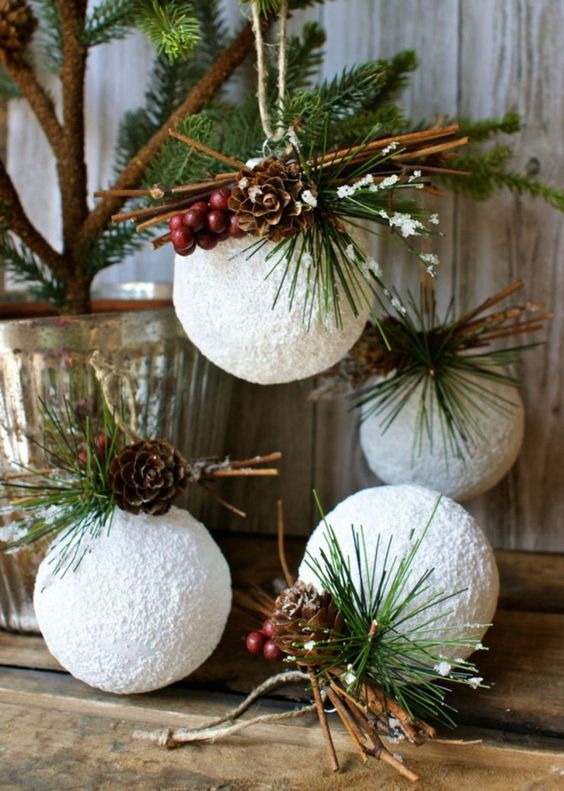 White rustic Christmas ornaments with pinecones