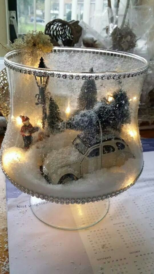 DIY rustic Christmas decor with snow globe in a hurricane glass