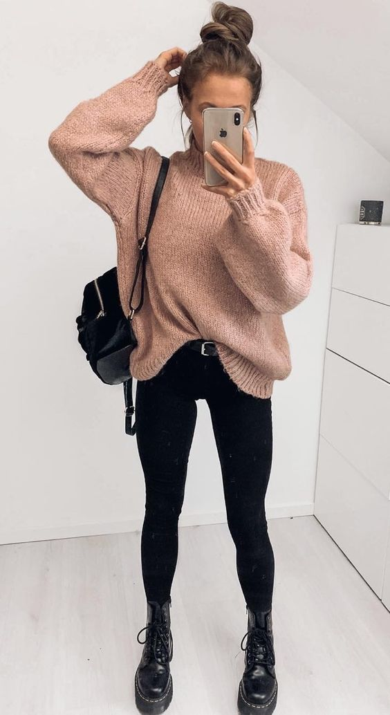 Black jeans outfits with beige sweater and Doc Martens boots