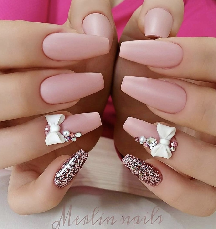 Matte pink acrylic coffin nails by Merlin Nails