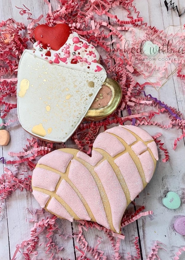 Cute valentine's day cookies with pink hearts and hot chocolate
