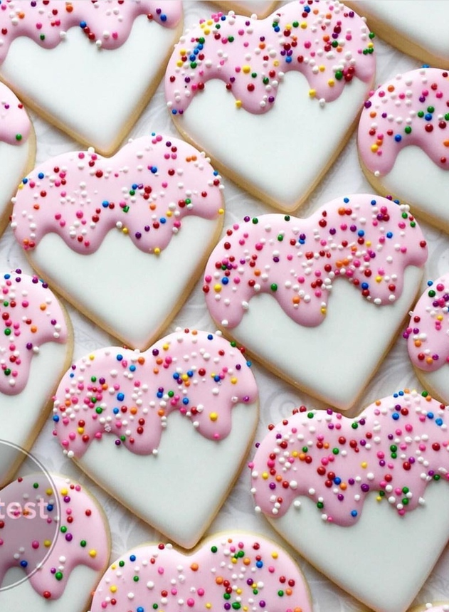 Cute valentine's day cookies and heart shaped cookies with sprinkles