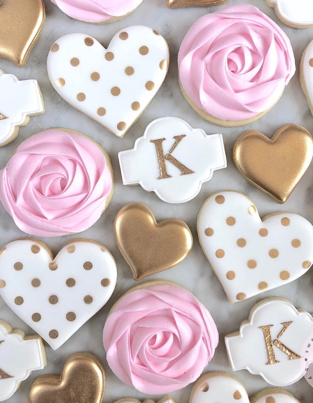 Pink, gold and white cute valentine's day cookies and heart shaped cookies