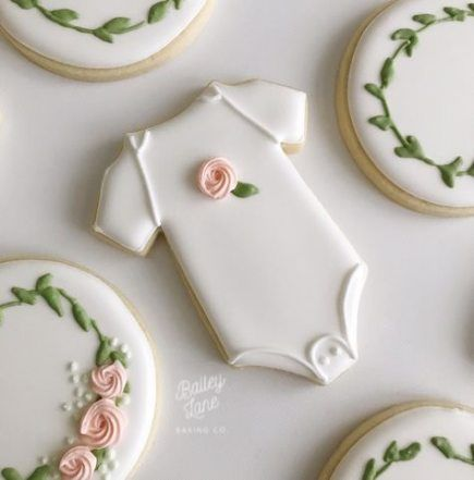 White bip baby shower cookies with roses