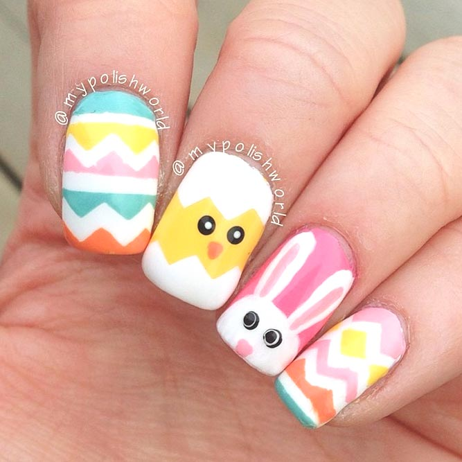Cute colorful Easter nails with chick nail art and bunny nail art