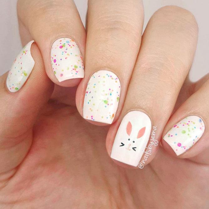 Cute white Easter nails with bunny nail art and polka dots